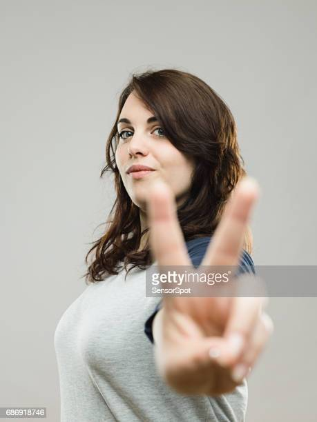 Real woman showing victory sign