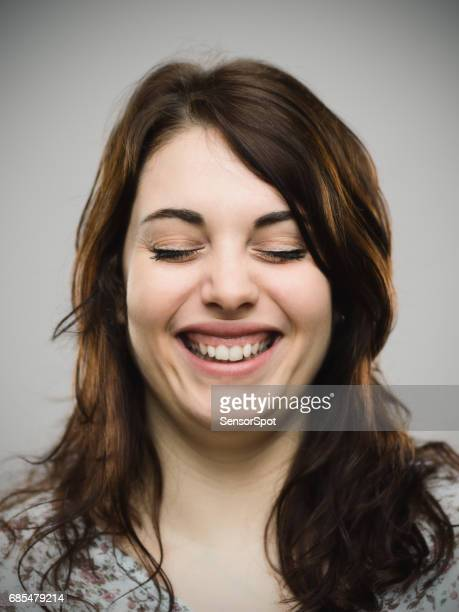 Real woman smiling with her eyes closed