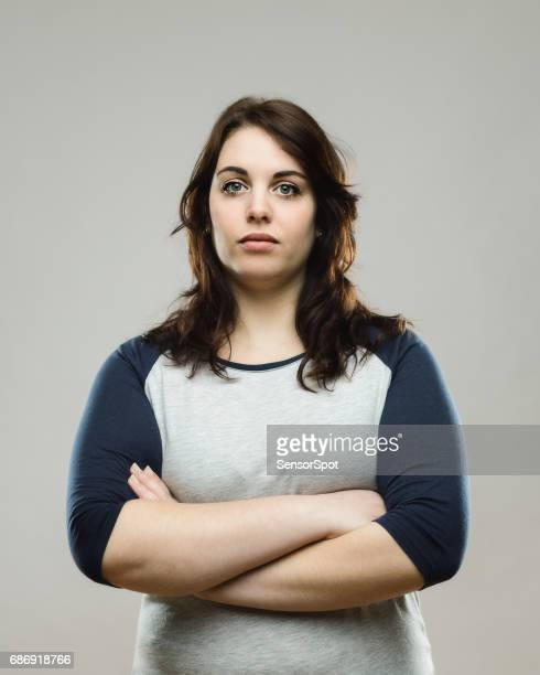 real woman standing with her arms crossed - blank expression stock pictures, royalty-free photos & images
