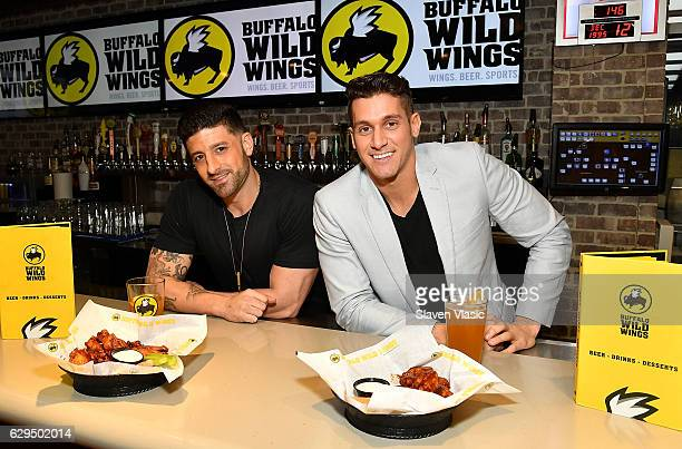 MTV Real World Seattle Bad Blood cast members Michael Crescenzo and Peter Romeo visit Buffalo Wild Wings on December 12 2016 in New York City