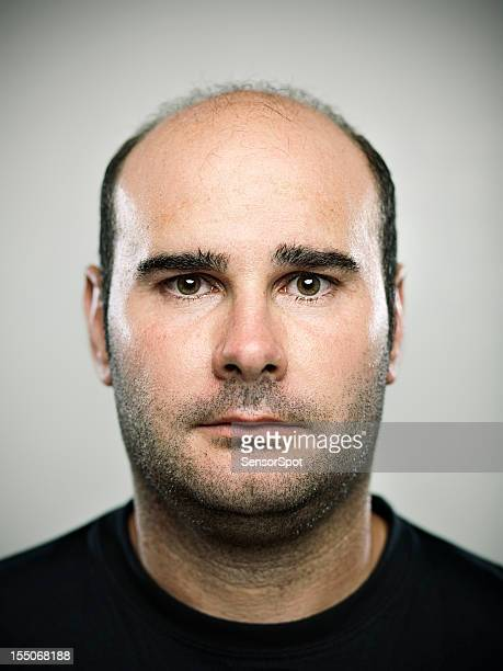 real young man - fat bald men stock pictures, royalty-free photos & images