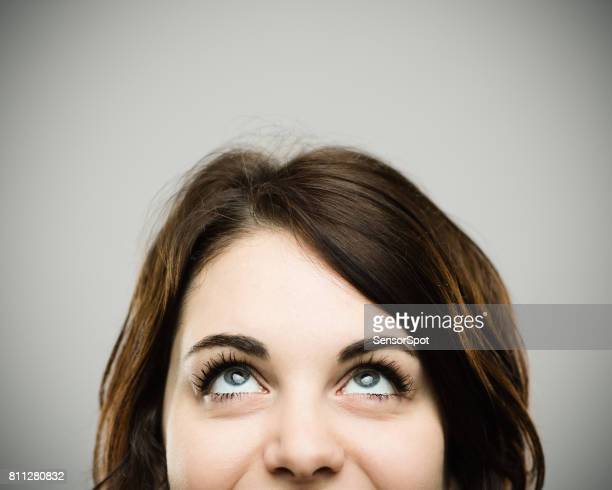 real young woman looking up and smiling - looking up stock pictures, royalty-free photos & images
