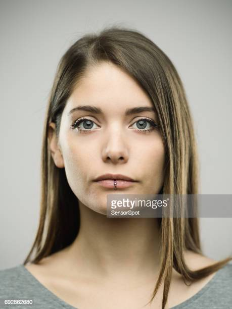 real young woman studio portrait - police mugshot stock pictures, royalty-free photos & images