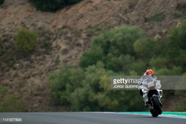 Reale Avintia Racing's Spanish rider Tito Rabat does a wheelie during the third MotoGP free practice session of the Spanish Grand Prix at the Jerez -...