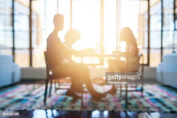 realising their vision together - defocused stock pictures, royalty-free photos & images