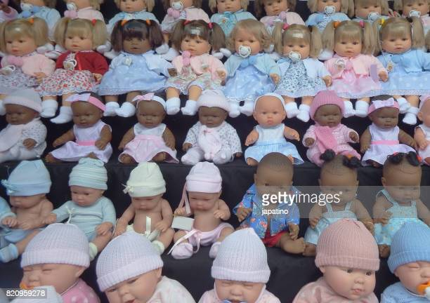 Realistic dolls for sale at a street stall