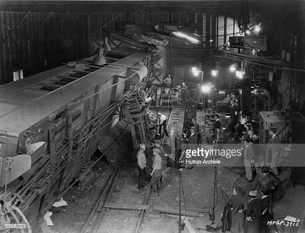 Realistic train wreck in the studio of MGM, reconstructed for a scene in the silent film 'Excuse Me', directed by Alfred J Goulding.