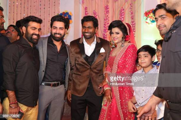 Reality show winner Manveer Gujjar with Indian cricketer Parvinder Awana and Sangit Awana during their wedding reception at Shiv Garden on March 10...