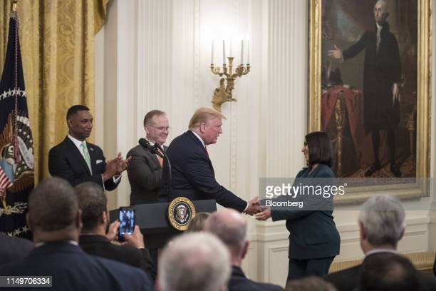 Reality star and activist Kim Kardashian West, right, shakes hands with U.S. President Donald Trump before speaking about a second chance hiring and...