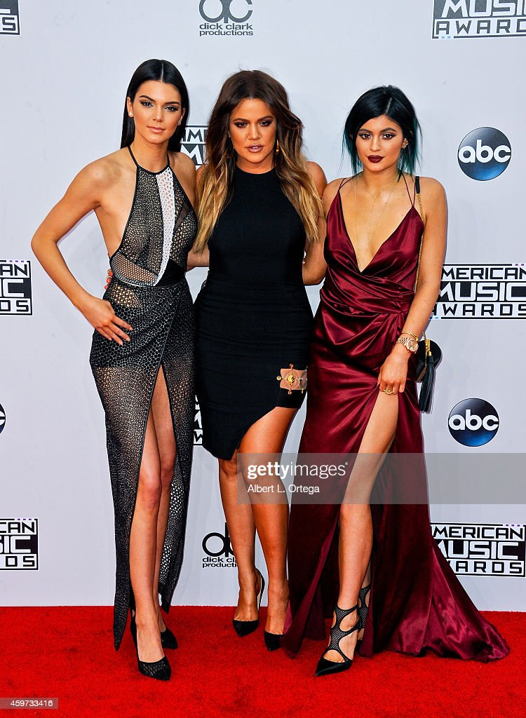 Reality stars Kendall Jenner, Kylie Jenner and Khloe Kardashian arrive for the 42nd Annual American Music Awards held at Nokia Theatre L.A. Live on November 23, 2014 in Los Angeles, California.