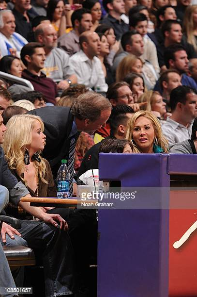 Reality television personality Adrienne MaloofNassif is approached by television sportscaster Jim Gray during a game between the Sacramento Kings and...