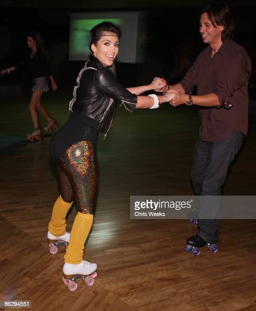 Reality television personality Kim Kardashian and Jonathan Cheban attend a party launching Pepsi Throwback at World on Wheels on April 29 2008 in Los...