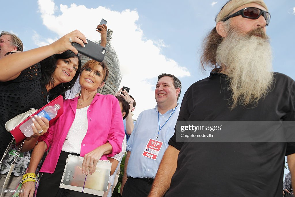 Reality television personality Phil Robertson (R) and Sarah Palin visit with supporters during a rally against the Iran nuclear deal on the West Lawn of the U.S. Capitol September 9, 2015 in Washington, DC. Thousands of people gathered for the rally, organized by the Tea Party Patriots, which featured conservative pundits and politicians.
