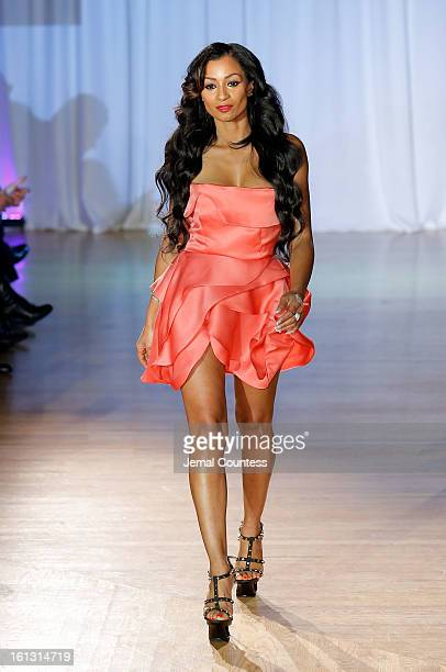 Reality TV actress Karlie Redd walks the runway at the Reality of FASHION the Reality of AIDS fall 2013 fashion show during MercedesBenz Fashion Week...