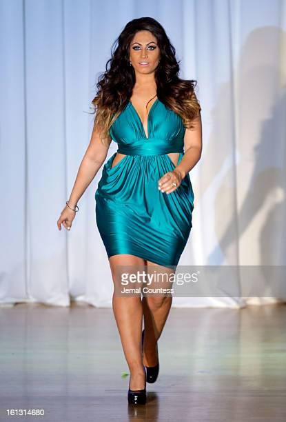 Reality TV actress Tracy DiMarco walks the runway at the Reality of FASHION the Reality of AIDS fall 2013 fashion show during MercedesBenz Fashion...