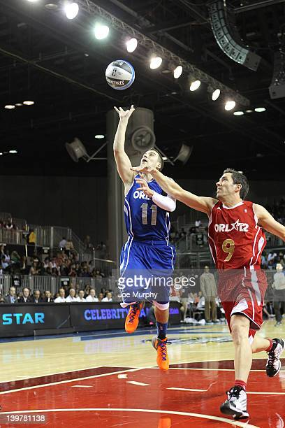 Reality TV celebrity Vinny Guadagnino of the East shoots the ball over Actor Drew Scott of the West team during the Sprint AllStar Celebrity Game on...