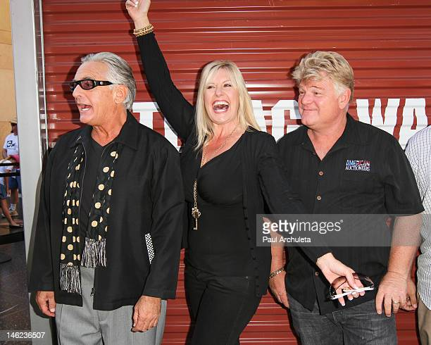Reality TV Personalities Barry Weiss Laura Dotson and Dan Dotson attends AE's Storage Wars Lockbuster Tour at Hollywood Highland Courtyard on June 12...