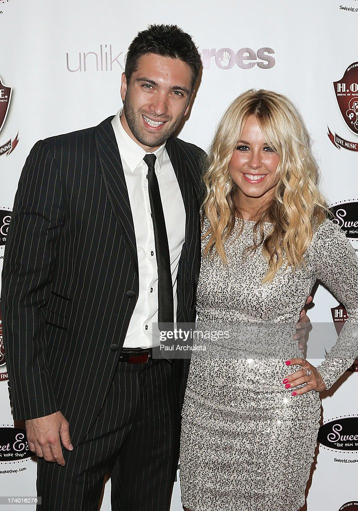 Reality TV Personalities Dmitry Chaplin (L) and Chelsie Hightower (R) attend the birthday celebration for Chelsie Hightower and Peta Murgatroyd and also supporting the 'Unlikely Heroes' charity organization on July 18, 2013 in Los Angeles, California.