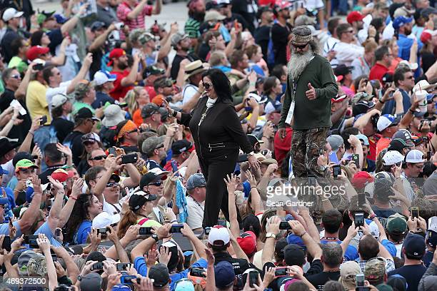 Reality TV personalities Kay Robertson and Phil Robertson of Duck Dynasty take part in prerace ceremonies for the NASCAR Sprint Cup Series Duck...