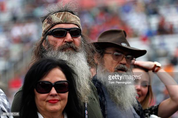 Reality TV personalities Kay Robertson Phil Robertson and Si Robertson take part in prerace ceremonies for the NASCAR Sprint Cup Series Duck...
