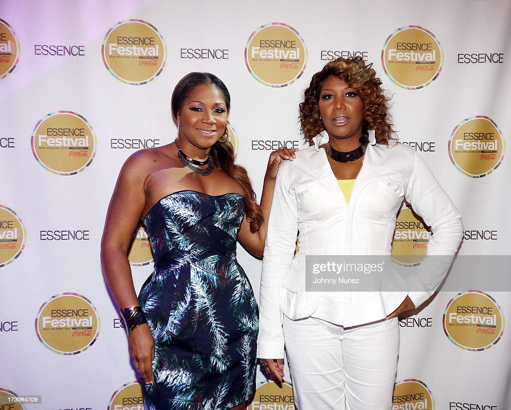 Reality TV personalities Trina Braxton and Traci Braxton attend the 2013 Essence Festival at the Ernest N. Morial Convention Center on July 6, 2013 in New Orleans, Louisiana.