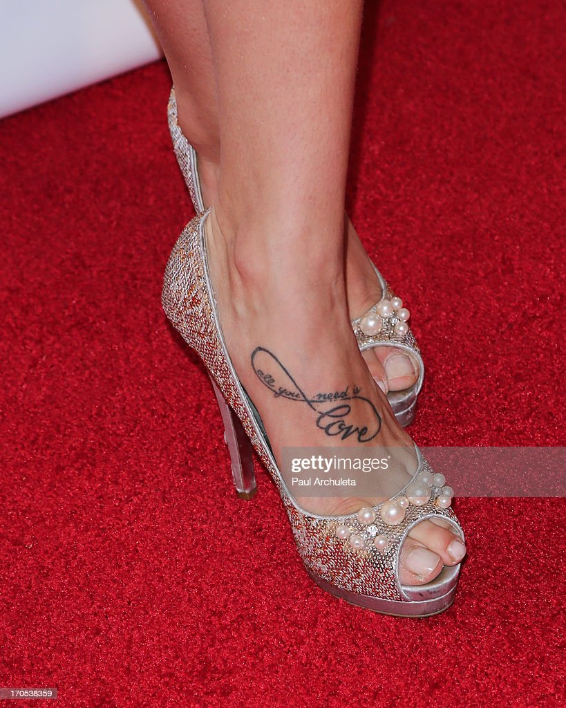 Reality TV Personality / dancer Sharna Burgess (shoe and tattoo detail) attends the West Coast Liberty Awards celebrating Lambda Legal's 40th anniversary at The London Hotel on June 13, 2013 in West Hollywood, California.