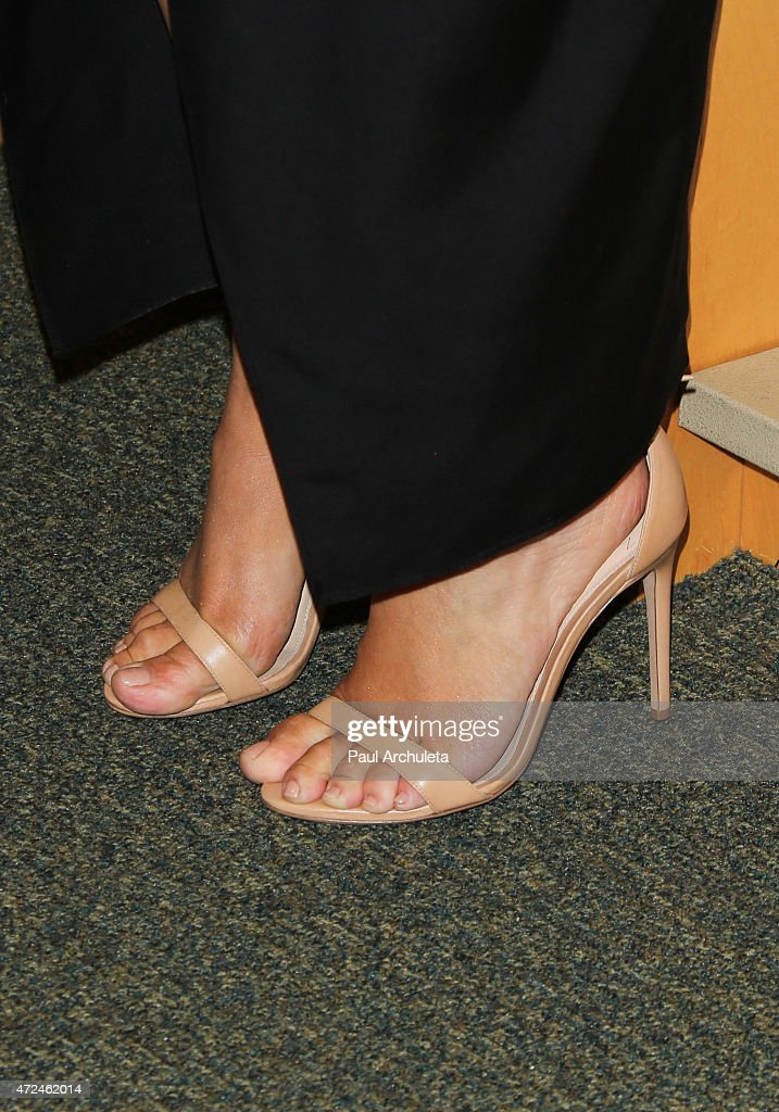 Reality TV Personality Kim Kardashian West, shoe detail, signs