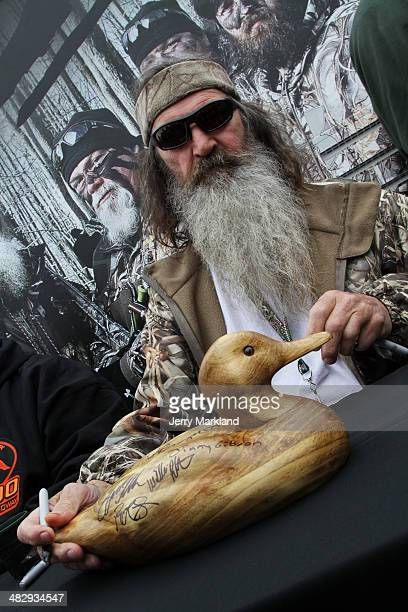 Reality TV personality Phil Robertson greets fans in the Duck Commander Compound at Texas Motor Speedway on April 5 2014 in Fort Worth Texas