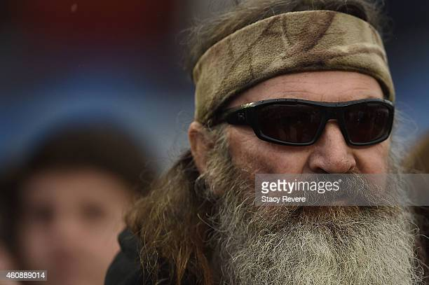 Reality TV personality Phil Robertson participates in pregame ceremonies for the Duck Commander Independence Bowl between the South Carolina...