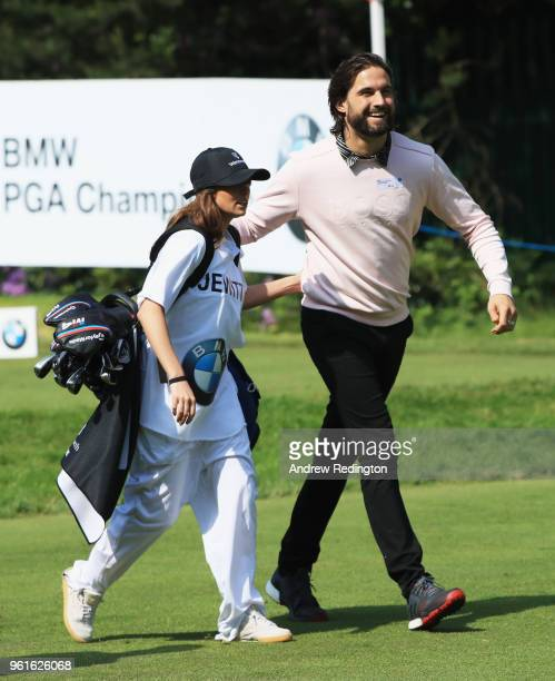 Reality TV star Jamie Jewitt and caddie and partner Camilla Thurlow walk off the tee during the BMW PGA Championship Pro Am tournament at Wentworth...