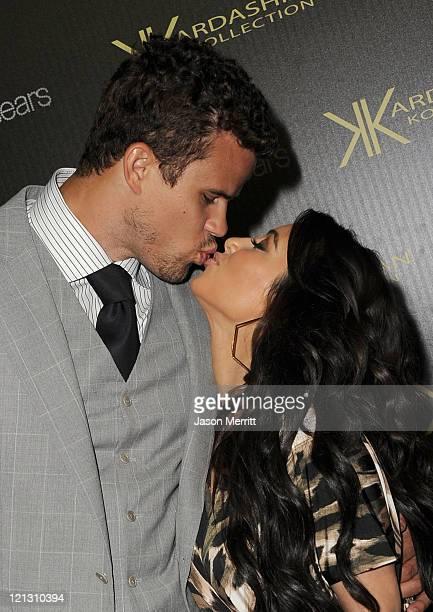 Reality TV star Kim Kardashian and New Jersey Nets forward basketball player Kris Humphries kiss on the red carpet of the Kardashian Kollection...