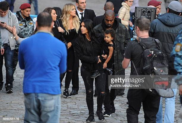 US reality TV star Kim Kardashian holds her daughter North next to her rapper husband Kanye West on April 9 2015 near the Geghard Monastery in...