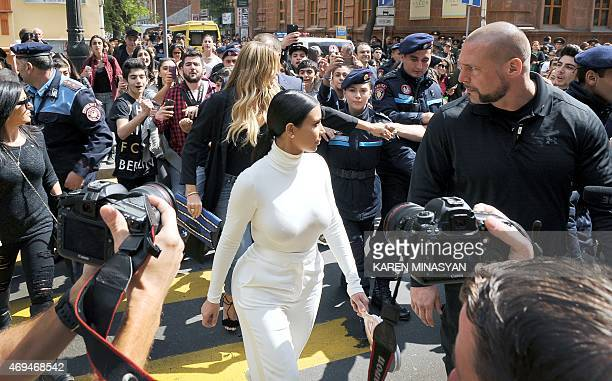 Reality TV star Kim Kardashian walks in the street followed by a crowd in Yerevan on April 12 as part of her first visit to Armenia to celebrate her...