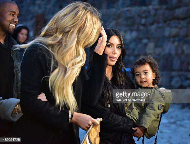 US reality TV star Kim Kardashian with her rapper husband Kanye West and their daughter North on April 9 2015 visit the Geghard Monastery in Armenia...