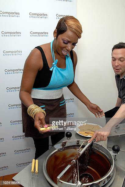 Reality TV star NeNe Leakes samples a fresh chocolatecovered graham cracker she has just created at Comparte's Chocolatier confectionary house on...