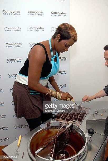 Reality TV star NeNe Leakes samples a fresh chocolatecovered marshmallow she has just created at Comparte's Chocolatier confectionary house on June...