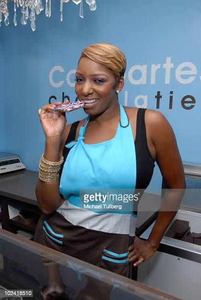 Reality TV star NeNe Leakes samples some sweets at Comparte's Chocolatier confectionary house on June 25 2010 in Brentwood California
