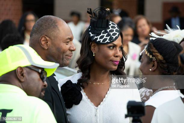 Reality TV star Omarosa ManigaultNewman speaks with people after attending soul music icon Aretha Franklin's funeral at Greater Grace Temple August...