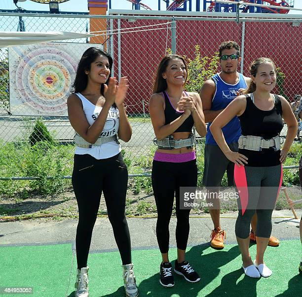 Reality TV stars Jaclyn Methuen and Davina Kullar of 'Married At First Sight' Visit The Trapeze School at Pier 40 on August 22 2015 in New York City