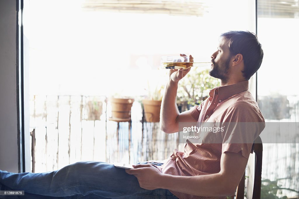 Really enjoying that beer : Stock Photo