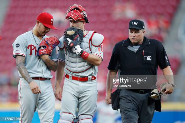 Realmuto and Vince Velasquez of the Philadelphia Phillies talk on the mound as home plate umpire Marvin Hudson waits in the second inning against the...