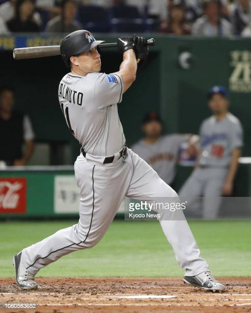 JT Realmuto of the Major League Baseball AllStars hits a solo homer in the fourth inning of Game 3 of the MLB allstar series against Samurai Japan in...