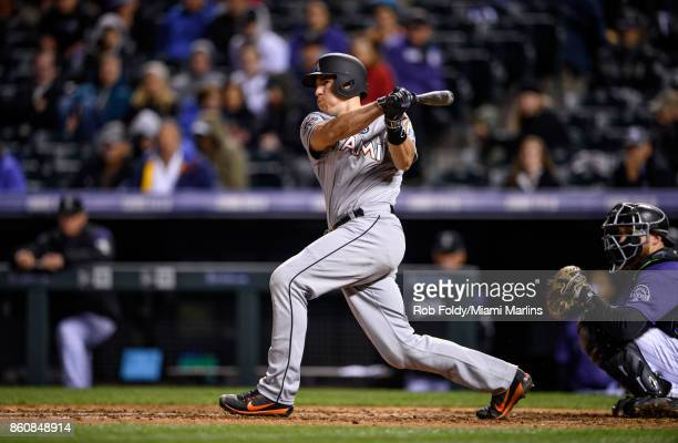 T Realmuto of the Miami Marlins at bat during the game against the Colorado Rockies at Coors Field on September 25 2017 in Denver Colorado
