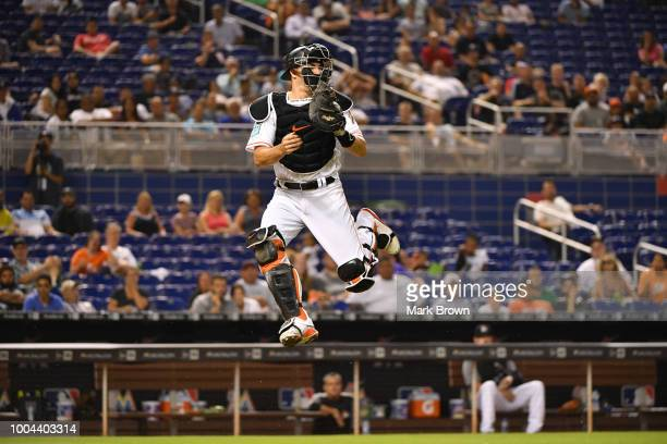 T Realmuto of the Miami Marlins attempts to catch the throw from the outfield in the seventh inning against the Atlanta Braves at Marlins Park on...