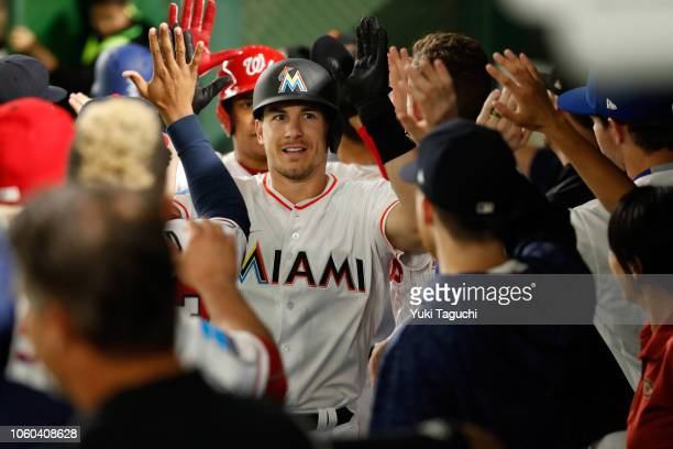 T Realmuto of the Miami Marlins celebrates after hitting a home run during the Japan AllStar Series game against Team Japan at the Tokyo Dome on...