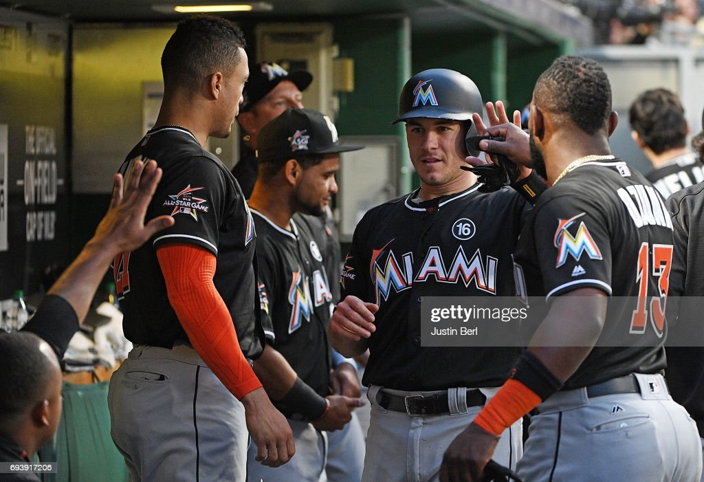 J.T. Realmuto #11 of the Miami Marlins celebrates with teammates in the dugout after coming around to score on an RBI single by Tyler Moore #28 in the fifth inning during the game against the Pittsburgh Pirates at PNC Park on June 8, 2017 in Pittsburgh, Pennsylvania.