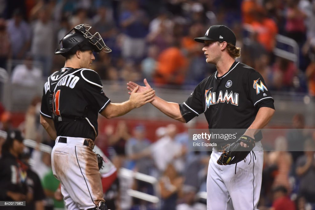 J.T. Realmuto #11 of the Miami Marlins congratulates Drew Steckenrider #71 after defeating the Philadelphia Phillies at Marlins Park on September 2, 2017 in Miami, Florida.