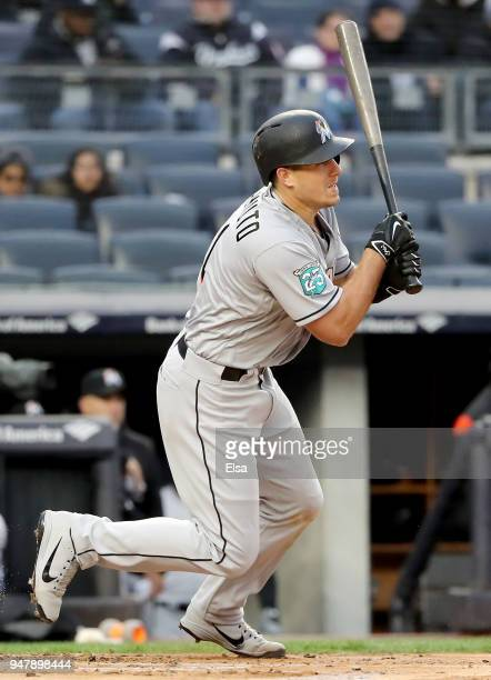 T Realmuto of the Miami Marlins drives in two with this hit in the first inning against the New York Yankees at Yankee Stadium on April 17 2018 in...
