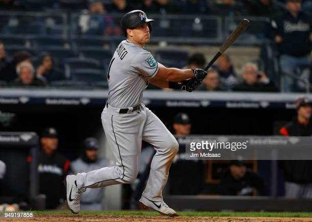 JT Realmuto of the Miami Marlins follows through on his home run against the New York Yankees at Yankee Stadium on April 17 2018 in the Bronx borough...
