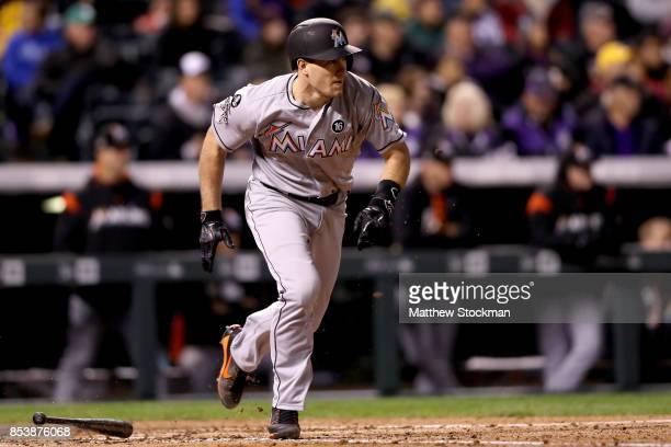 T Realmuto of the Miami Marlins hits a RBI single in the fourth inning against the Colorado Rockies at Coors Field on September 25 2017 in Denver...